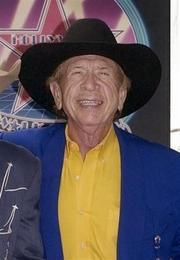 Photo Buck Owens, seen in Los Angeles on June 5, 2003, the flashy 'rhinestone cowboy' who shaped the sound of country music and helped introduce the genre to mainstream America on the long-running TV show 'Hee Haw,' has died. He was 76. Owens died early Saturday, March 25, 2006 at his home, said a family spokesperson. The cause of death was not immediately known.(AP Photo/Nick Ut)