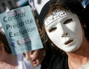 Photo: A woman wears a mask with the initials of the youth job contract law, 'CPE' and 'CNE', as she takes part in a nationwide protest demanding the French government scrap the First Job Contract (CPE) youth jobs law during a march in Paris April 4, 2006. French transport workers and teachers staged new strikes on Tuesday and students across the country gathered for street protests they hope will kill off the disputed CPE, a youth hire-and-fire law. The poster in the background reads 'Contract, Precariousness, Exclusion.' REUTERS/Yves Hermann