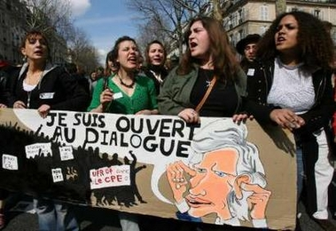 Photo: Students shout slogans as they hold a sign with a caricature of France's Prime Minister Dominique de Villepin with the message 'I'm Open to Dialogue' as they take part in a nationwide protest demanding the French government scrap the First Job Contract (CPE) youth jobs law during a march in Paris April 4, 2006. French transport workers and teachers staged new strikes on Tuesday and students across the country gathered for street protests they hope will kill off the disputed CPE, a youth hire-and-fire law. REUTERS/Jacky Naegelen