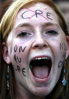 Photo: A student shouts slogans during a national strike day demanding the government withdraw the CPE during a demonstration in Nice, France, April 4, 2006. (Eric Gaillard/Reuters)