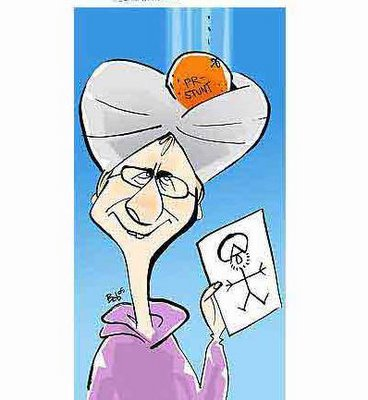 Danish Muslim Cartoons KÃ¥re Bluitgen, wearing a turban with the proverbial orange dropping into it, with the inscription 'Publicity stunt'. In his hand is a stick drawing of Muhammad. An 'orange in the turban' is a Danish proverb meaning 'a stroke of luck.'
