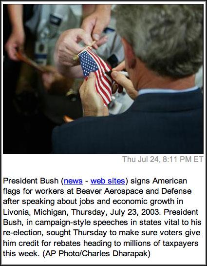President Bush Signs Flag