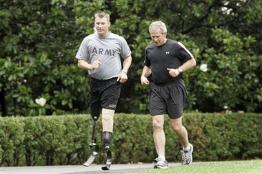 President Bush runs with SSG Christian Bagge wounded Iraq vet