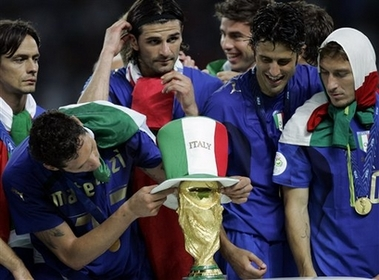 Italy Beats France for 2006 World Cup Title Photo taly's Marco Materazzi puts on a hat on the trophy as Fabio Grosso, second from right, and Francesco Totti, right, look on at the end of the final of the soccer World Cup match between Italy and France in the Olympic Stadium in Berlin, Sunday, July 9, 2006. (AP Photo/Thomas Kienzle)