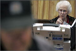 Old Lady Voting And the photo accompanying the piece says more than