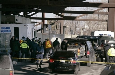 Boston Aqua Teen Hunger Force Terror Plot - Members of the Massachusetts Bay Transit Authority police, the Masachusetts State Police and the Boston Bomb Squad respond to a suspicious package found near the Sullivan Square subway station in Boston, Wednesday morning, Jan. 31, 2007. Four additional suspicious devices, similar in nature to the one found Wednesday morning, were found Wednesday afternoon in four different areas of the city. All devices proved to be hoaxes. (AP Photo/Adam Hunger)