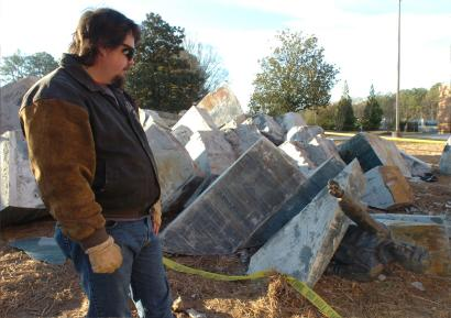 Spaceship Earth Sculpture Photo: AFTER: Kennesaw State University employee John Kirtley examines a pile of rubble that was once the sculpture 'Spaceship Earth.' It collapsed last Thursday during campus holiday break.