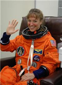 Lisa Marie Nowak in Orange NASA Flight Suit (small)