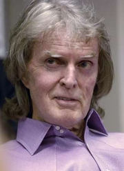 Don Imus Purple Shirt Photo Radio talk-show host Don Imus speaks with Rev. Al Sharpton (not pictured) during Sharpton's radio show, in New York, in this April 9, 2007 file photo, where Imus apologized for insensitive remarks he made last week about the Rutgers women's basketball team. CBS Corp. said on Thursday it would permanently cancel Imus' morning radio talk program, following racist and sexist comments made by the shock jock about a women's college basketball team. REUTERS/Chip East/Files (UNITED STATES)