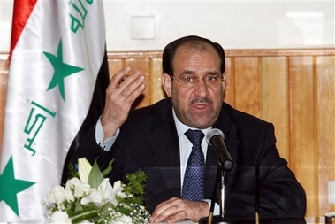 Maliki Threatens to Take His Ball and Go Home Photo Iraqi Prime Minister Nouri al-Malki speaks during a joint press conference with his Syrian counterpart, Mohammad Naji Ottari, Damascus Wednesday, Aug. 22, 2007. Al-Malki is on a three-day visit to Syria for talks with Syrian officials on ways of boosting bilateral relations and achieving a national reconciliation in Iraq. (AP Photo/Bassem Tellawi).