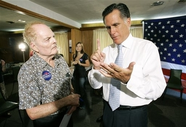 Romney Sons Join Campaign, Not Army Republican presidential hopeful, former Mass. Gov. Mitt Romney, right, talks with Dearld Nanke, of Mechanicsville, Iowa, during a visit to The Cove diner in Moscow, Iowa, Wednesday, Aug. 8, 2007. (AP Photo/Charlie Neibergall)