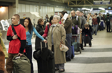 Airport Delays Photo Passengers on a busy travel day wait on line at Chicago's O'Hare Airport Scott Olson / Getty