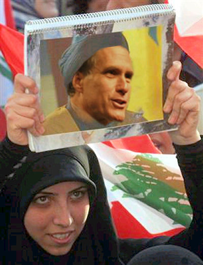Muslim Woman Holding Mitt Romney Picture