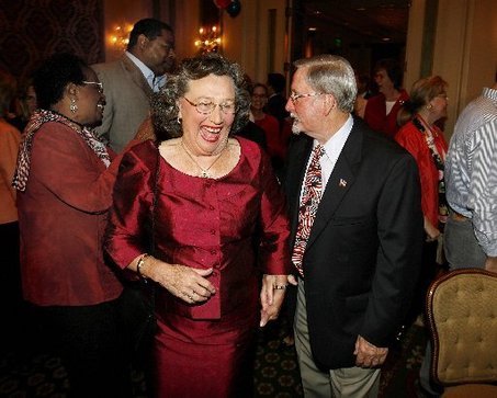 New Orleans Council Now Majority White STAFF PHOTO BY ELIOT KAMENITZA joyous Jackie Clarkson enters the grand ballroom at the Royal Sonesta Saturday night, escorted by her husband Arthur Buzz Clarkson, for an election night victory party.
