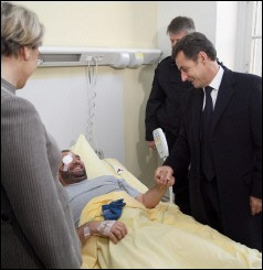 Sarkozy Vows to Punish Gun-Toting Rioters