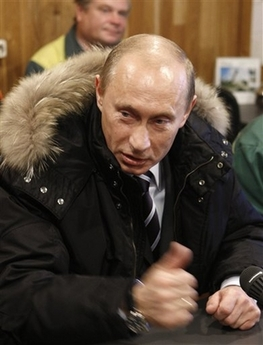 Vladimir Putin Jacket Photo Russian President Vladimir Putin talks with workers at their meeting in the Siberian city of Krasnoyarsk, Tuesday, Nov. 13, 2007. (AP Photo/Misha Japaridze)