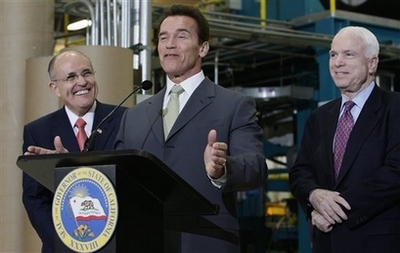 Schwarzenegger, Giuliani and McCain Republicans California Gov. Arnold Schwarzenegger, center, endorses Republican presidential hopeful, Sen. John McCain, R-Ariz., as former New York City Mayor Rudy Giuliani looks on at left, Thursday, Jan. 31, 2008, after a tour of Solar Integrated Technologies in Los Angeles. (AP Photo/Charles Dharapak)
