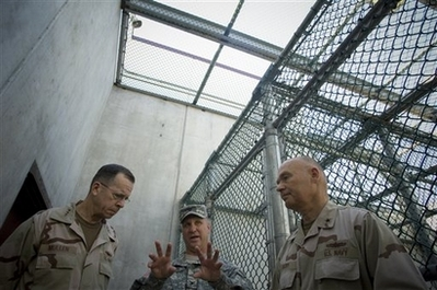 Joint Chiefs Chairman: Close Guantanamo In this photo released by the Department of Defense, Col. Bruce Vargo, center, joint detention group commander, gives a tour of a detainee recreation area at Camp Six, Joint Task Force Guantanamo, Cuba, to Chairman of the Joint Chiefs of Staff, Navy Adm. Mike Mullen and Rear Adm. Mark Buzby, commander, Joint Task Force Guantanamo, Sunday Jan. 13, 2008. Mullen said Sunday he favors closing the prison as soon as possible because he believes negative publicity worldwide about treatment of terrorist suspects has been