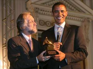 Obama Beats Clinton at Grammys U.S. Senator Barack Obama (D-IL) (R) poses with his Grammy awarded to him by Grammy President Neil Portnow during a 'Grammys on the Hill' event on Capitol Hill in Washington September 6, 2006.  REUTERS/Molly Riley  (UNITED STATES)