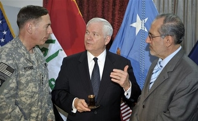 Bob Gates with David Petraeus Photo In this photo provided by the Department of Defense, U.S. Army Gen. David Petraeus, Commanding General Multi National Force Iraq, Secretary of Defense Robert M. Gates and Iraqi National Security Advisor Dr. Al Rubai'e discuss Iraqi defense issues during an unannounced visit by Secretary Gates after he left the 44th Munich Security Conference, Sunday, Feb. 10, 2008, in Baghdad, Iraq. (AP Photo/Department of Defense, Tech. Sgt. Jerry Morrison)