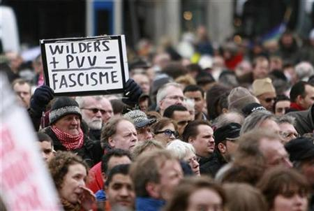 Wilders Film 'Fitna' Incites Muslims Protest Photo A demonstrator holds a sign during a protest against Dutch politician and anti-Islam film-maker Geert Wilders at Dam square in Amsterdam March 22, 2008. REUTERS/Ade Johnson