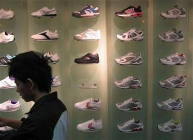 Sneakers the Sign of a Leader? A sneaker store in China's southern city of Guangzhou February 17, 2008. A recent poll has found that people who buy three pairs of sneakers or more a year are far more likely to be a leadership type that other people. (Joseph Chaney/Reuters)