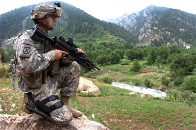 Why Isn't the Army Broken?  U.S. Army Spc. Jason Curtis provides security for members of a medical civil action project in Parun, Afghanistan, on June 28, 2007. Curtis is assigned to Charlie Company, 1st Battalion, 151st Infantry Regiment.    DoD photo by Sgt. Brandon Aird, U.S. Army. (Released)