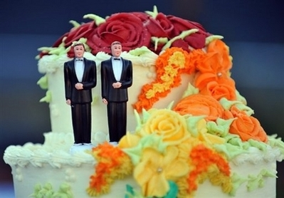 Gay Wedding Cake A wedding cake with statuettes of two men is seen in West Hollywood, California, May 15. California will hold its first gay marriages starting on June 17, state authorities told its public officials Wednesday, two weeks after the state Supreme Court quashed a ban on gay marriage in a historic ruling. (AFP/Gabriel Bouys)