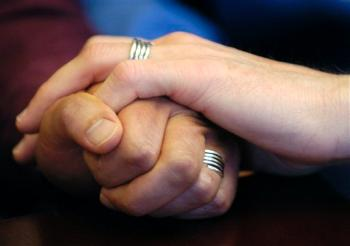 Gay Marriage Photo Stuart Gaffney, left, and John Lewis, right, embrace hands with their wedding bands on in San Francisco on Friday, June 30, 2006. More California voters now support allowing same-sex marriage than oppose it, according to a new poll released Wednesday, May 28, 2008. (AP Photo/Benjamin Sklar)