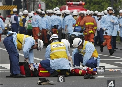 Tokyo Stabbing Spree Photo Rescue workers from Tokyo Fire Department get ready with their equipment after their arrival in Tokyo's Akihabara district Sunday afternoon, June 8, 2008. A reported gangster went on a midday stabbing rampage in Tokyo's premier electronics and video game district Sunday, knifing at least 14 people. A news report said at least two of the victims were dead.<br /> (AP Photo/Itsuo Inouye)