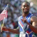 Tyson Gay holds the U.S. flag after winning the men\'s 100 meters final at the U.S. Olympic Track and Field Trials in Eugene, Oregon June 29, 2008. (Mike Blake/Reuters)