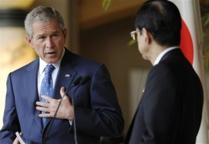 US President George W. Bush, left, gestures during a joint press conference with Japanese Prime Minister Yasuo Fukuda at the G8 summit Sunday, July 6, 2008 in the lakeside resort of Toyako on Japan\'s northern island of Hokkaido. (AP Photo/Evan Vucci)