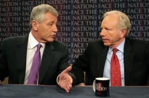 In this photo provided by CBS, Sen. Joseph Lieberman, D-Conn., listens to Sen. Chuck Hagel, R-Neb., left, on CBS\'s \