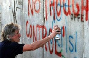 Pink Floyd co-founder Roger Waters spray-paints the words \