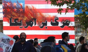 Iranians pass a US flag with a sign reading \'Death to America\' as they attend a rally in Tehran, in 2004. Photograph: Hasan Sarbakhshian/AP