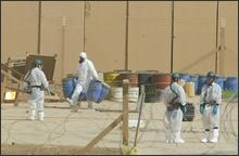 In a Monday June 9, 2003 file photo, UN inspectors from the International Atomic Energy Agency (IAEA) work at the nuclear facility in Tuwaitha, Iraq, 50 kms east of Baghdad. The last major remnant of Saddam Hussein\'s nuclear program - a huge stockpile of concentrated natural uranium - reached a Canadian port Saturday, July 5, 2008, to complete a secret U.S. operation that included a two-week airlift from Baghdad and a ship voyage crossing two oceans. (AP Photo/Saurabh Das, file)