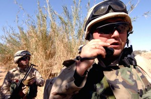 A company commander from the 13th Georgian Army Battalion radios in a situation report while conducting a joint clearing operation with Iraqi soldiers in Ali Shaheen, Iraq, March 7, 2008. U.S. Army photo by Sgt. Timothy Kingston