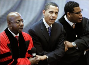 "Barack Obama links arms with Rev. Raphael Warnock, left, and associate pastor Shanan Jones as they sing ""We Shall Overcome\"" during a church service at Ebenezer Baptist Church. (AP)."