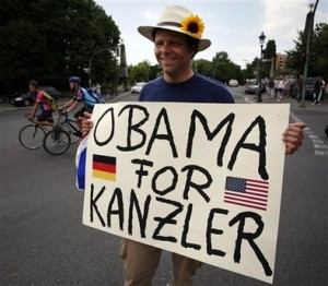 A supporter of U.S. Democratic presidential candidate Sen. Barack Obama, D-Ill., holds a poster meaning \'Obama for Chancellor\' prior to Obama\'s speech at the victory column in Berlin Thursday, July 24, 2008. (AP Photo/Miguel Villagran)
