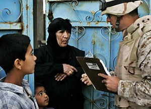 Speaking the same language: An Iraqi-American translator asks census questions in Khandari, Iraq, just west of Baghdad in 2006. Jacob Silberberg/AP/File