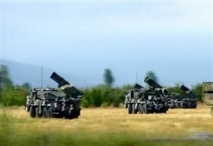 n this picture made off APTN video footage, Georgian multiple rocket launchers are seen at a position south of Tskhinvali, Friday morning, Aug. 8, 2008. The capital of Georgia\'s separatist region of South Ossetia came under heavy fire early Friday, just hours after Georgia\'s president declared a unilateral cease-fire. (AP Photo/APTN)