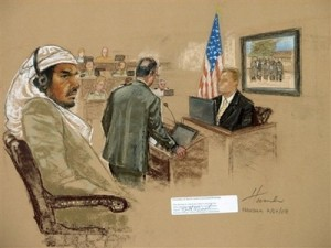 In this Thursday, July 24, 2008 file photograph of a sketch by courtroom artist Janet Hamlin, reviewed by the U.S. Military, defendant Salim Ahmed Hamdan, left, watches as FBI agent Craig Donnachie testifies about his interrogations of Hamdan, while a picture of disguised U.S. agents is displayed on a screen, during Hamdan\'s trial inside the war crimes courthouse at Guantanamo Bay U.S. Naval Base, in Cuba. A jury of six military officers reached a split verdict on Wednesday, Aug. 6, 2008, in the war crimes trial of Salim Ahmed Hamdan, clearing him of some charges but convicting him of others that could send him to prison for life. The judge scheduled a sentencing hearing for later Wednesday. (AP Photo/Janet Hamlin, Pool)
