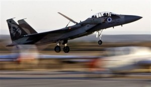 In this Thursday, Dec. 27, 2007 photo, an Israeli Air Force fighter plane lands during an acrobatics display at a graduation ceremony at the Hatzerim Air Force Base near the southern Israeli city of Beersheba. Israel appears increasingly confident that it would be able to deal a sharp setback to Iran\'s nuclear program, if not destroy it, through a military strike. (AP Photo/Kevin Frayer, File)