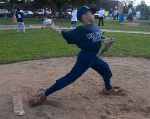 Jericho Scott, 9, warms up on the pitching mound in New Haven, Conn. Saturday Aug. 23, 2008. Officials with the Youth Baseball League of New Haven say they will disband Scott\'s team because his coach won\'t stop him from pitching. They say his hard throws may frighten other players in the baseball league for beginners. (AP Photo/Douglas Healey).