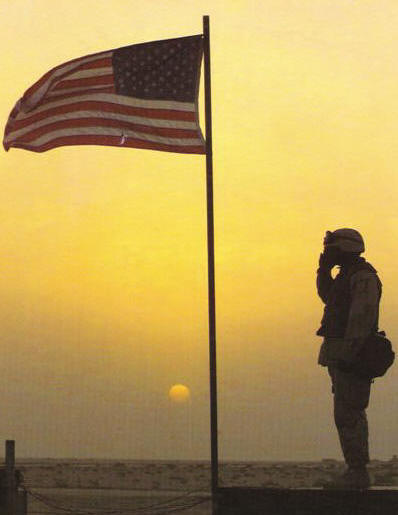 Soldier Saluting Flag at Sunset
