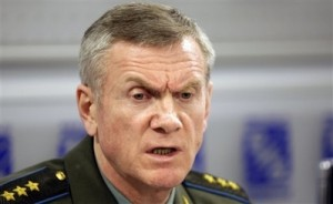 In this Aug. 13, 2008 file photo, Russia\'s deputy chief of General Staff Col.-Gen. Anatoly Nogovitsyn addresses the media in Moscow. Nogovitsyn said Friday, Aug. 15, 2008 that Poland\'s agreement to accept a U.S. missile defense battery exposes the country to attack, pointing out that Russian military doctrine permits the use of nuclear weapons in such a situation, the Interfax news agency reported. (AP Photo/Misha Japaridze, File)