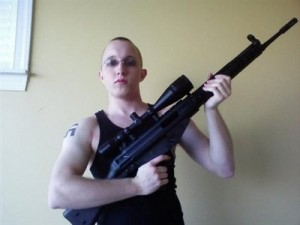 This undated photo obtained from a MySpace webpage shows Daniel Cowart, 20 of Bells, Tenn. holding a weapon. Federal agents have broken up a plot to assassinate Democratic presidential candidate Sen. Barack Obama, D-Ill. and shoot or decapitate 102 black people in a Tennessee murder spree, the ATF said Monday Oct. 27, 2008. In court records unsealed Monday, federal agents said they disrupted plans to rob a gun store and target a predominantly African-American high school by two neo-Nazi skinheads. The men, Daniel Cowart, 20, of Bells, Tenn., and Paul Schlesselman 18, of West Helena, Ark., are being held without bond. (AP Photo)
