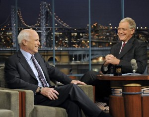 """U.S. Republican presidential nominee Sen. John McCain (R-AZ) speaks to host David Letterman (R) during an appearance on """"Late Show with David Letterman"""" in New York October 16, 2008."""