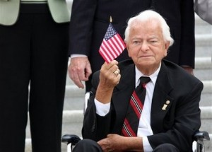 In this Sept. 11, 2008 file photo, Sen. Robert Byrd, D-W.Va, waves a flag during a ceremony on Capitol Hill in Washington in remembrance of the Sept. 11 terrorists attacks. Byrd, the longest-serving senator in history, is stepping down from his cherished post as chairman of the Senate Appropriations Committee. (AP Photo/Lauren Victoria Burke, File)