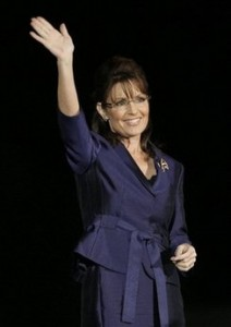 In this Nov. 4, 2008 file photo, Gov. Sarah Palin, R-Alaska, acknowledges the crowd during an election night rally in Phoenix. Oprah wants her, and so do Letterman and Leno. Fresh from her political defeat, Sarah Palin is juggling offers to write books, appear in films and sit on dozens of interview couches at a rate astonishing for any first-term governor, let alone a Hollywood star. (AP Photo/Elise Amendola, File)